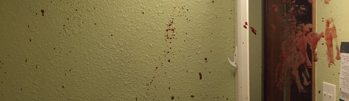 blood splatter on bathroom wall